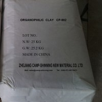Treated organophilic clay providing viscosity in oil based mud